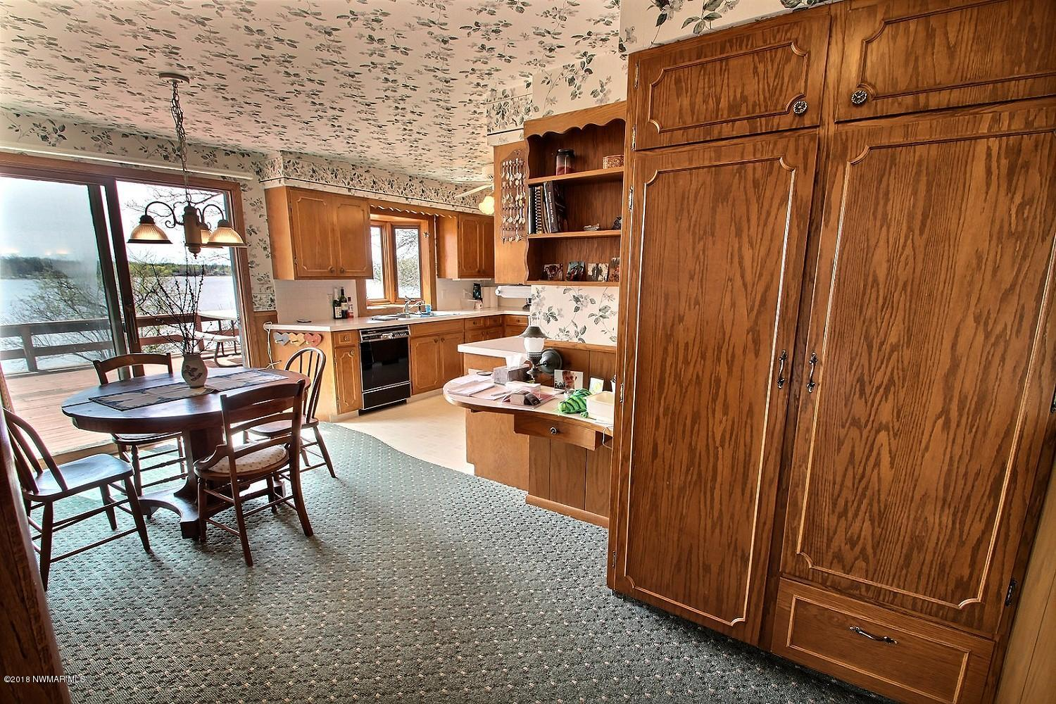 View of the dining room looking into the kitchen. Spread out and have plenty of space for all the family meals. Enjoy wonderful built-ins throughout the home.