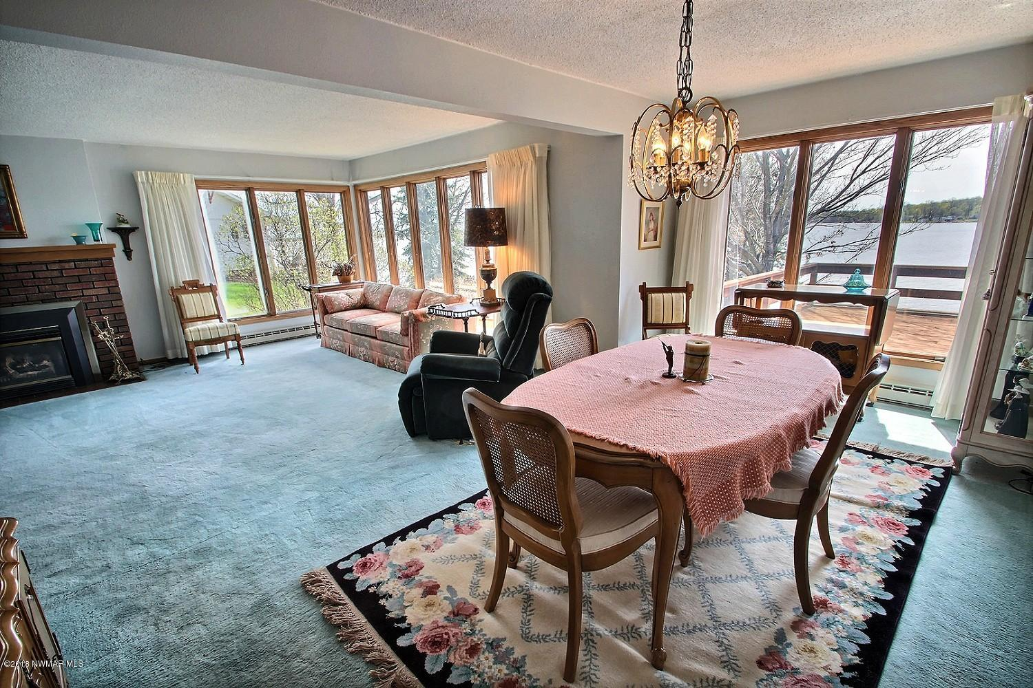 The main level has wonderful gathering spaces. The formal dining room opens to the living room, have plenty of space to spread out.