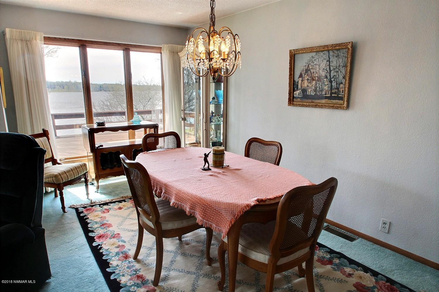 This gorgeous formal dining room boasts amazing views of Maple Lake. Invite friends and family over for holidays or weekends on the lake.
