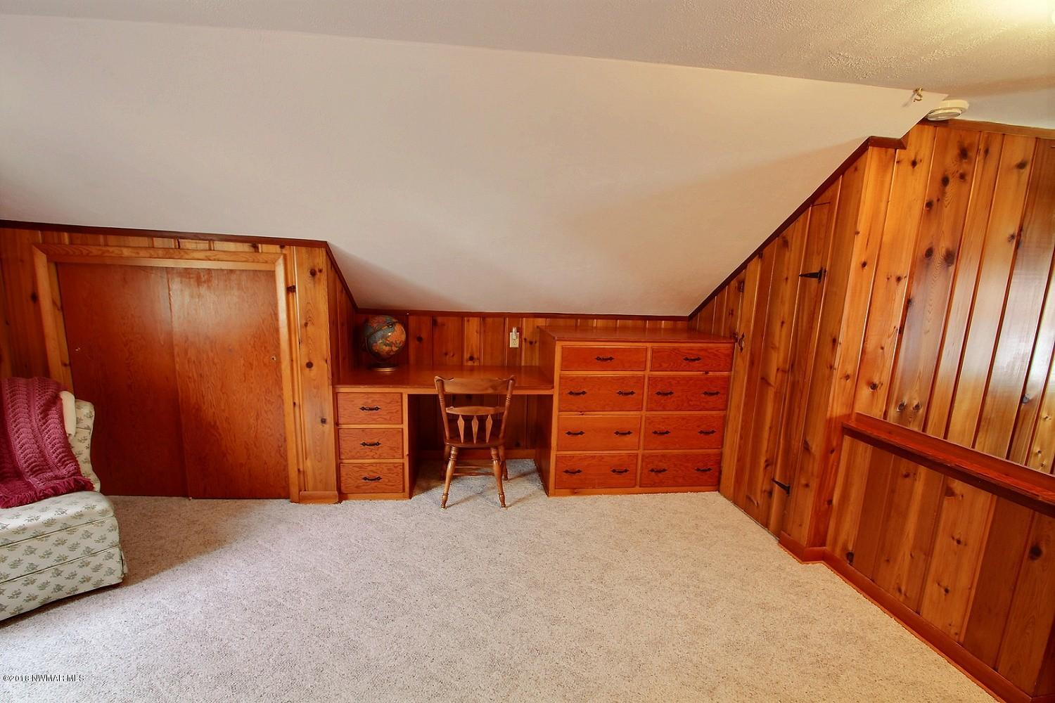 Another view of the third bedroom with built in dresser and extra storage space.
