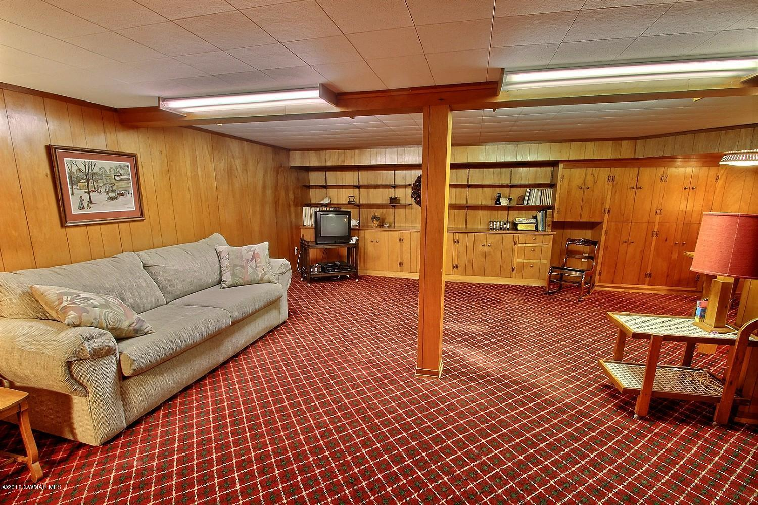 Spacious family room in the lower level offers plenty of gathering space.