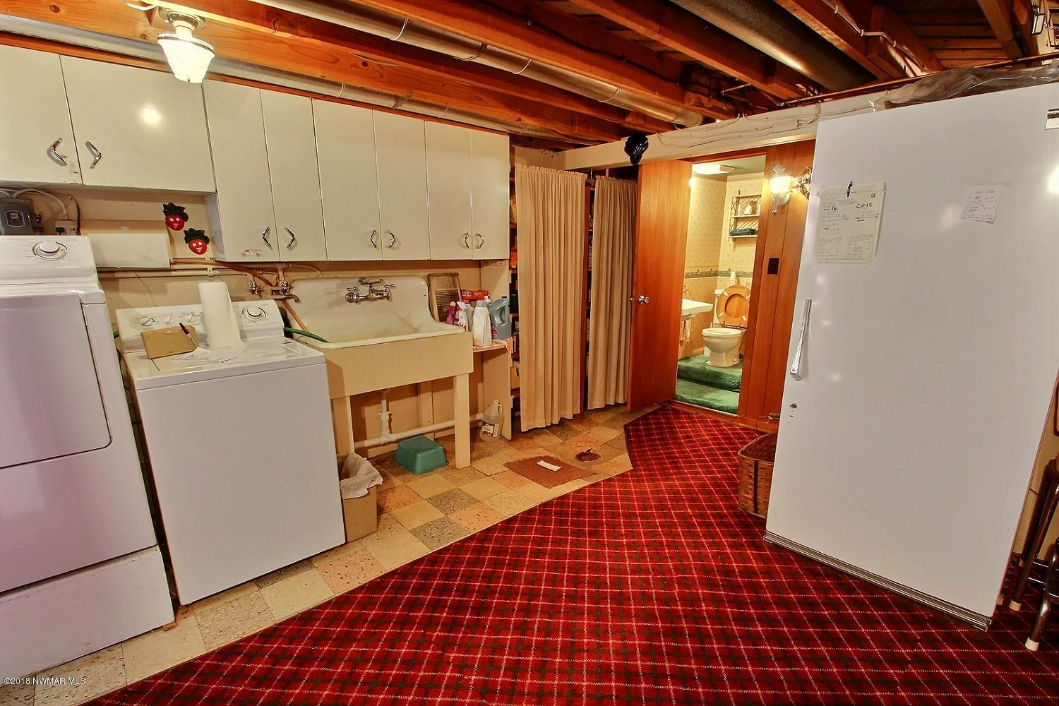 The laundry room/workshop/utility. There is a three-quarter bath. Includes fuel oil heat and heat pump.