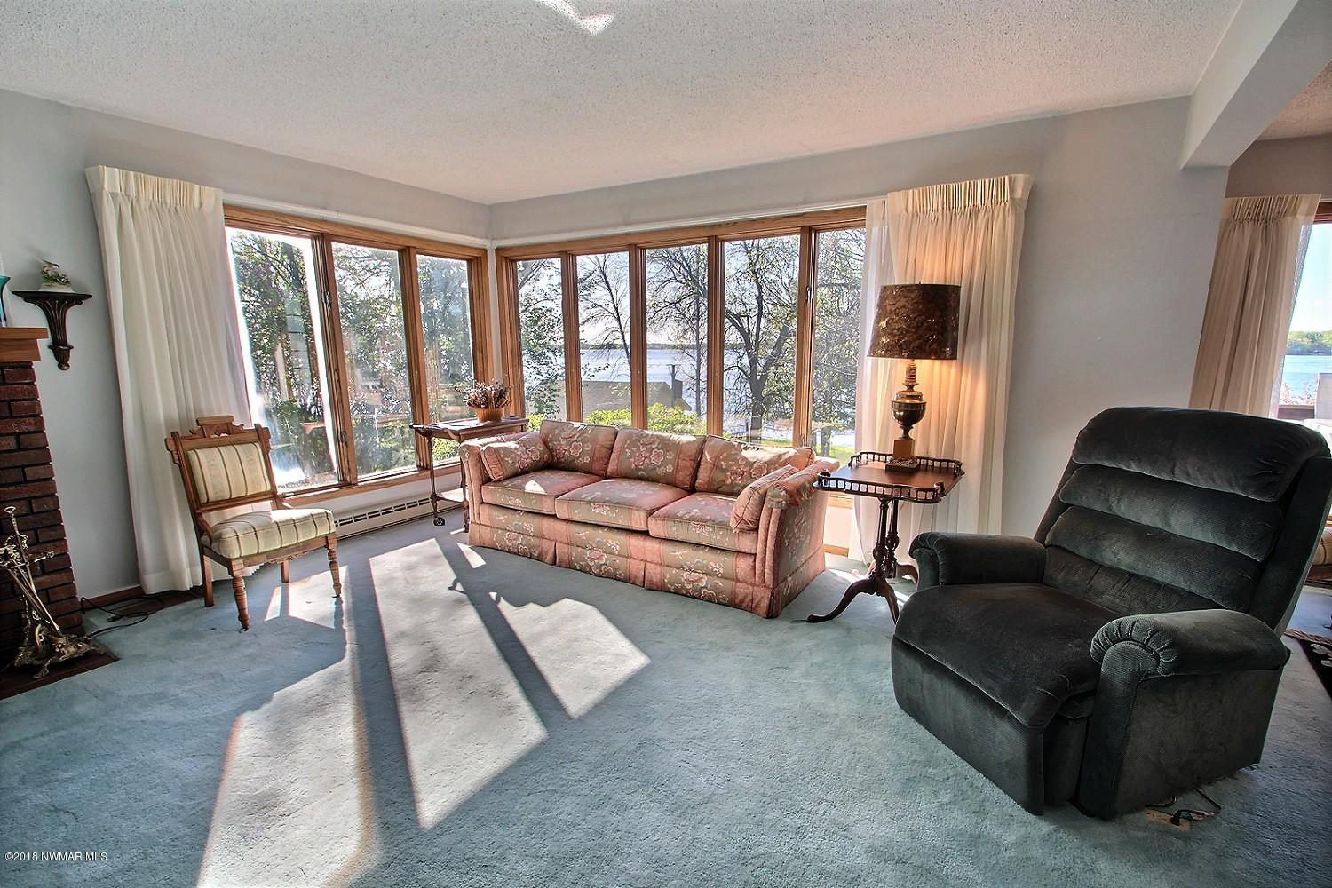 Dripping with natural light, the living room may just be your favorite spot in the home to enjoy the fantastic view of the lakeshore.