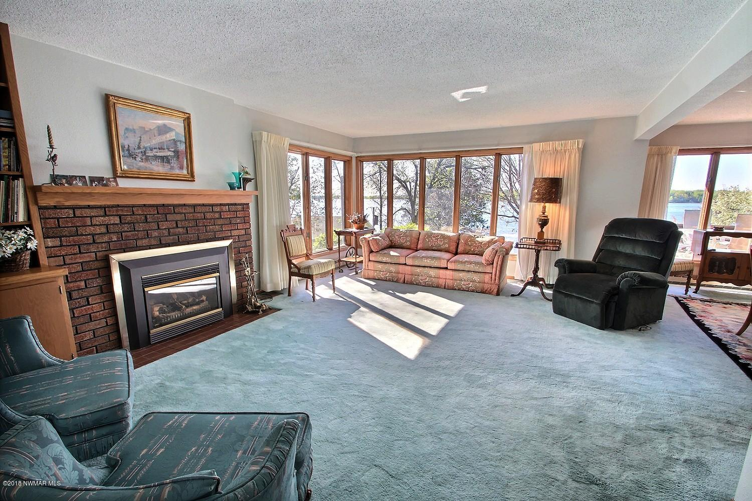The living room is warmed by a gas burning fireplace that you can enjoy anytime of the year. There is more than enough room for you furniture.