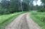 Driveway maintained with gravel from small pit on property.