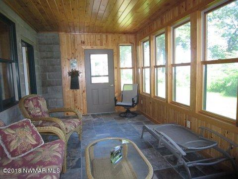 Slate fl, knotty pine walls & ceiling, new windows