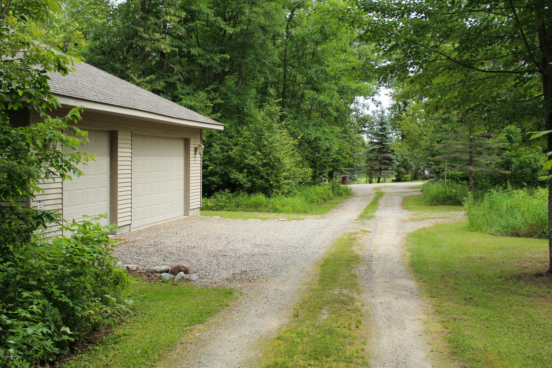 Detached garage, loop driveway