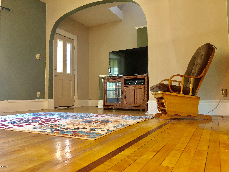 Original wood flooring in the living room