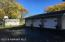 Outstanding 3 stall garage with heat. Asphalt driveway, to the garage and county road.