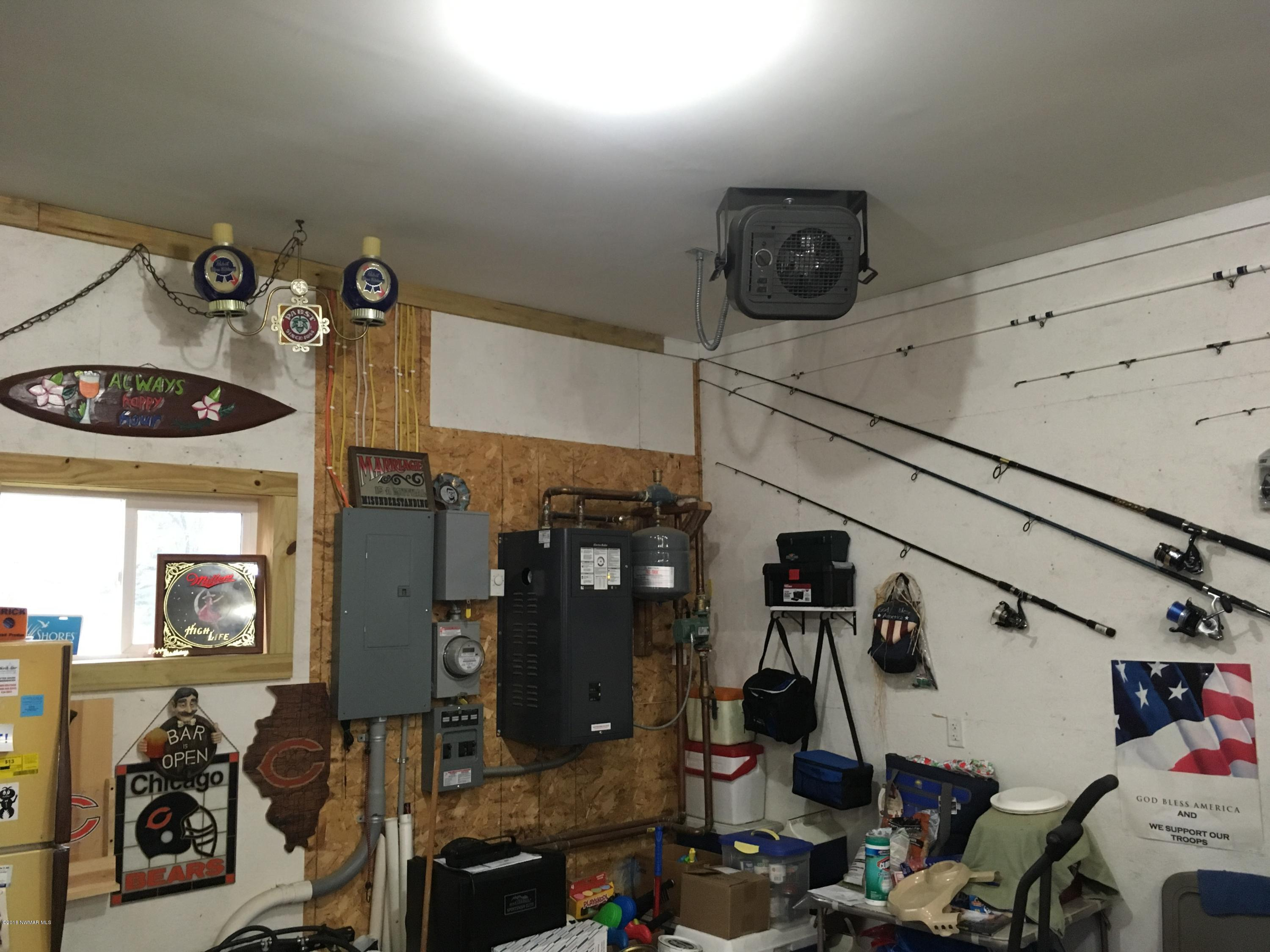 100 amp service , tubular heating in cement, plus electric heater on ceiling , with 2 overhead fans.