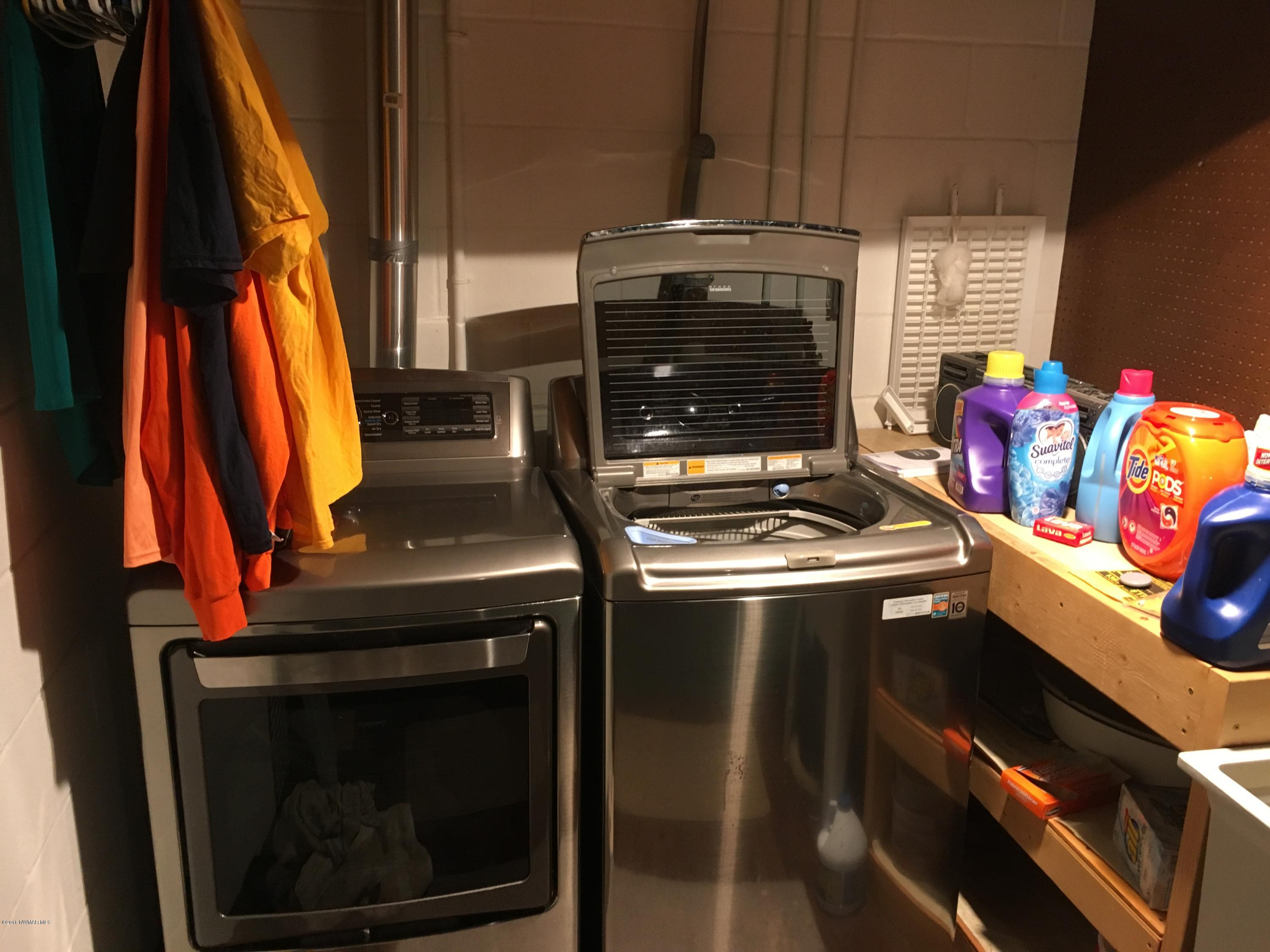 One year old-stainless steel washer and dryer.