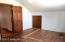 Again, the floors need a little work in this room, or a large scatter rug can be a good cover until you can get to it.