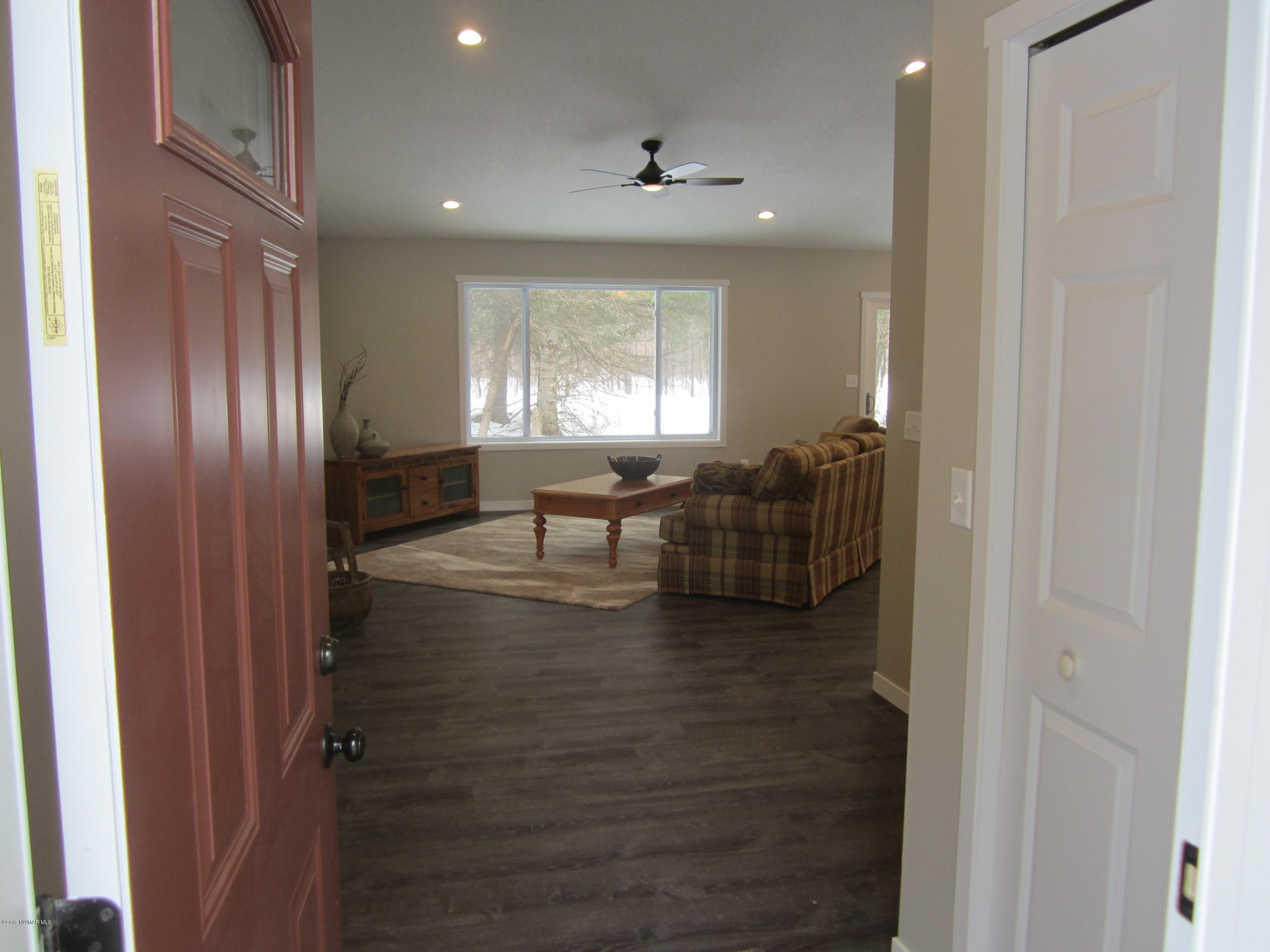 Enter your spacious, beautiful new home on 9 acres.