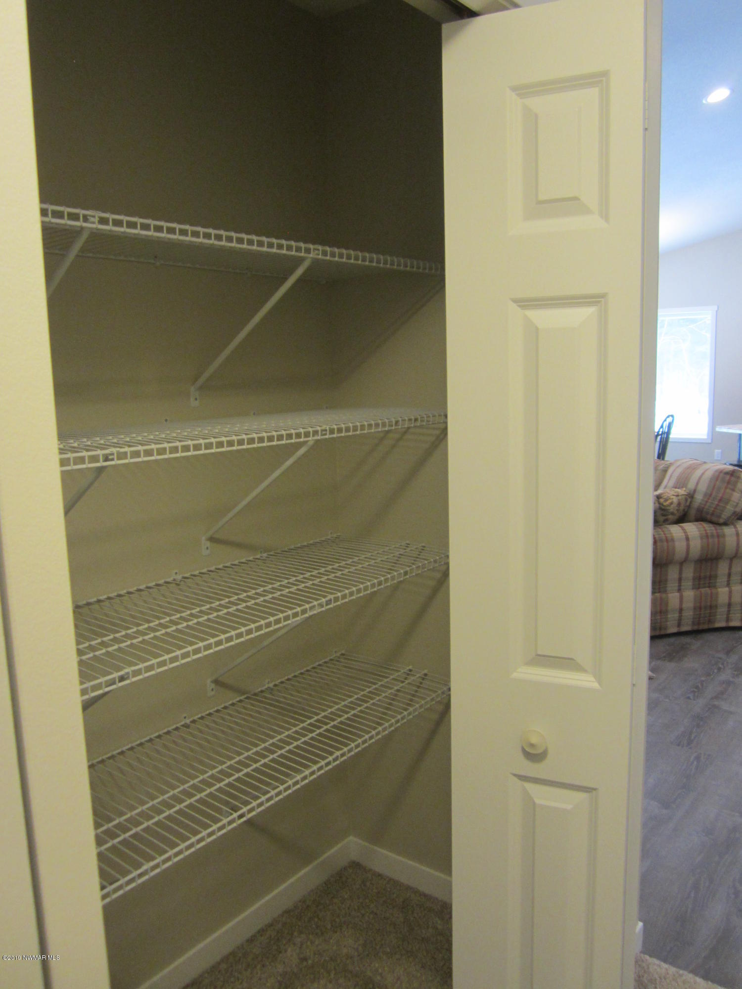 One of two hallway closets