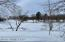 You cant see in the photo, but just across the creek you can see where deer have bedded down under the trees in the snow. Great wildlife and waterfowl views!