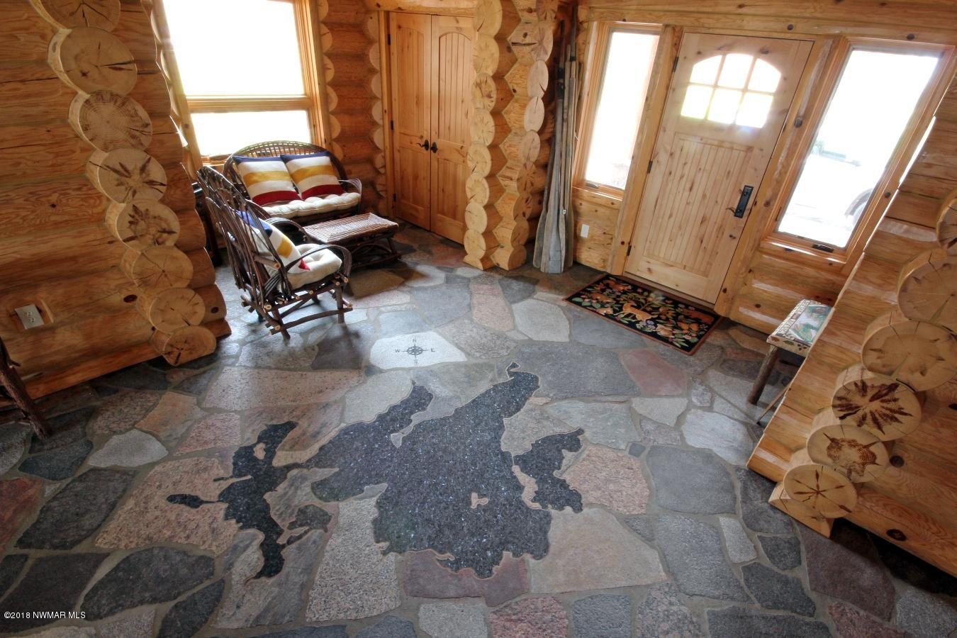 Welcome room with natural Granite Flagstone floor, 7 ft inlaid blue pearl granite map of Leech Lake.