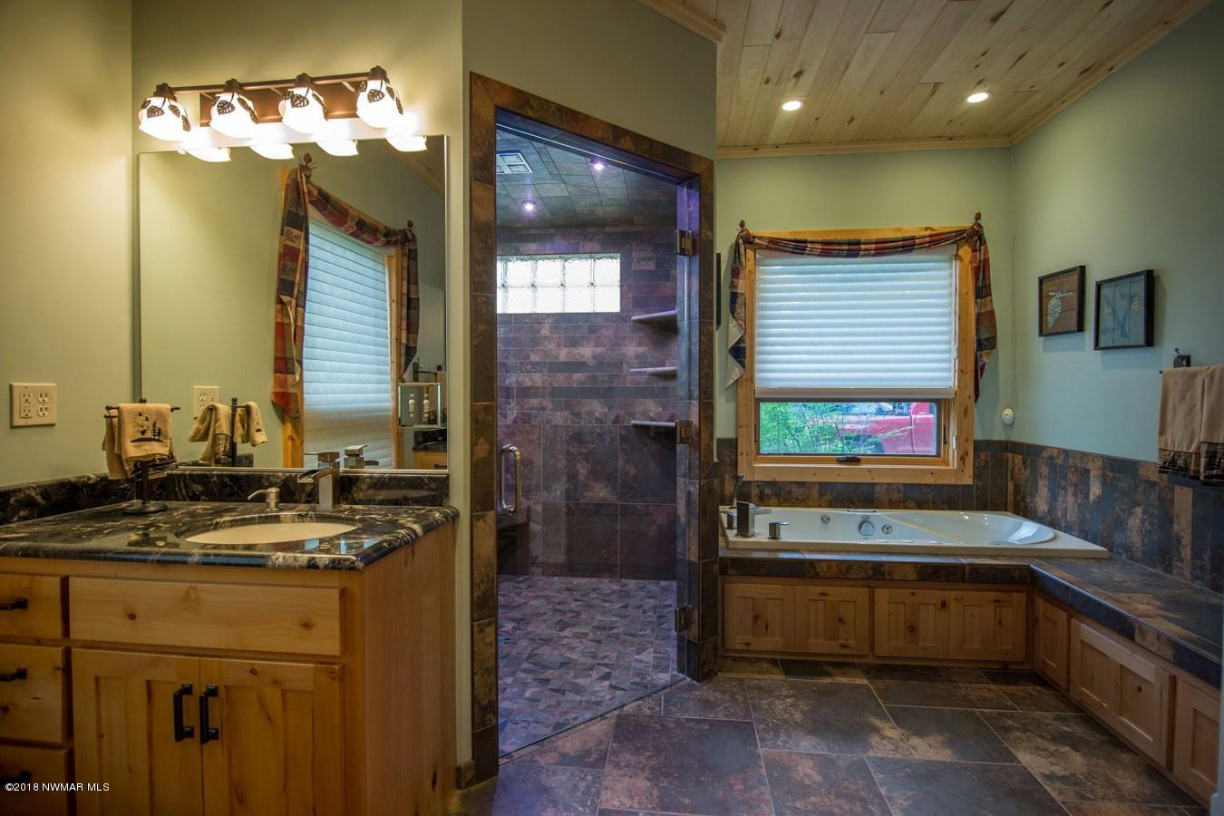 Master bath, as well as all bathrooms, have separate water closets. Shower has a programmable thermostatic valve for up to 6 individual shower selections and steam shower capability.