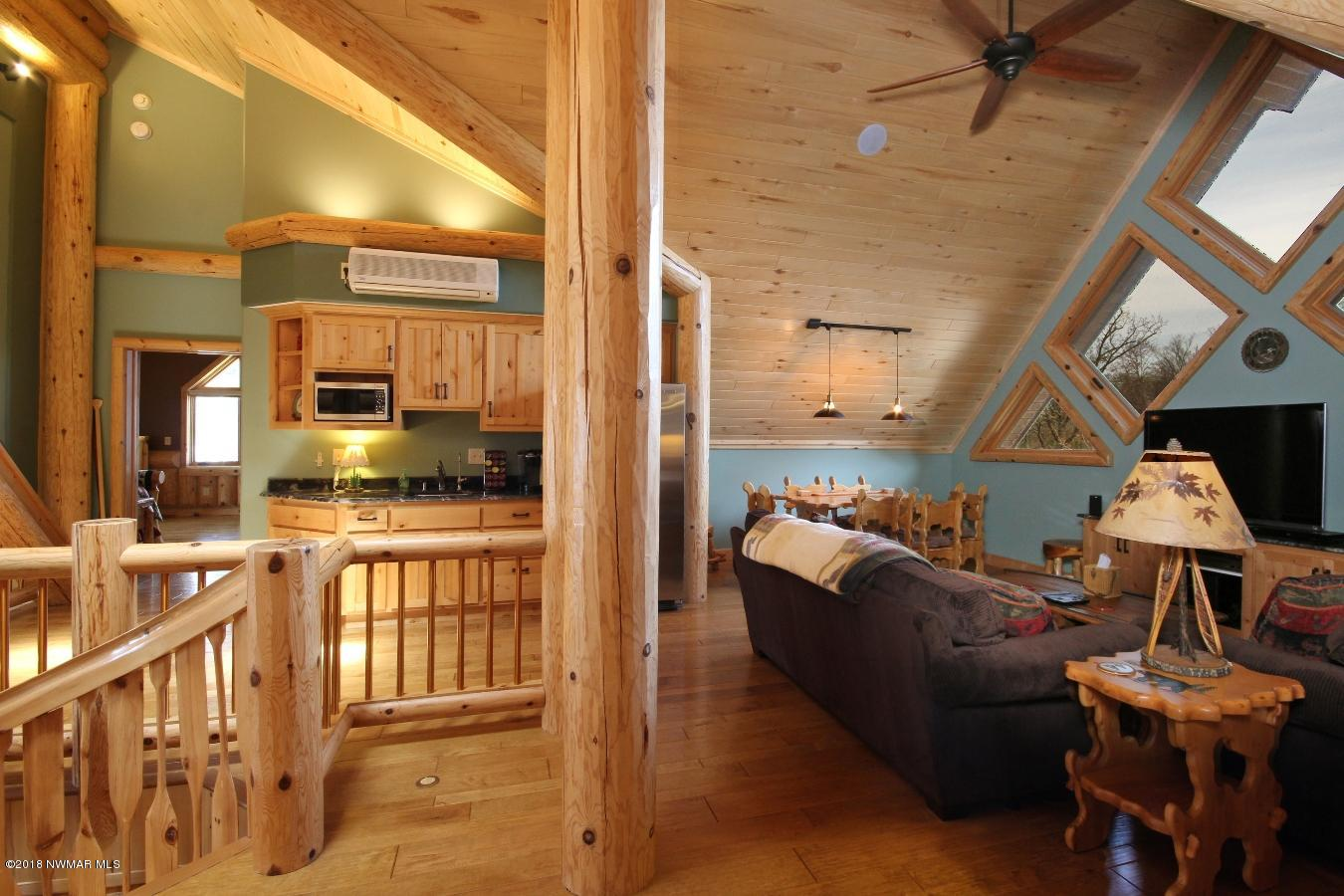 Ceilings are tongue and groove Aspen. All interior doors and cabinets are knotty alder.
