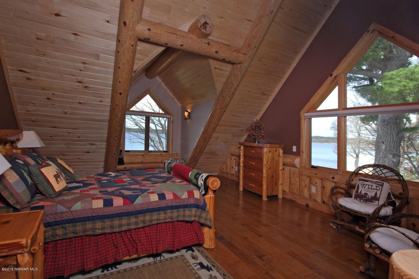 Bedroom #2 Bear Room All bedrooms have lake views, queen size log beds and en-suite baths.
