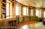 Beautiful woodwork with windows facing the south for lots of natural light and curved design adding character.