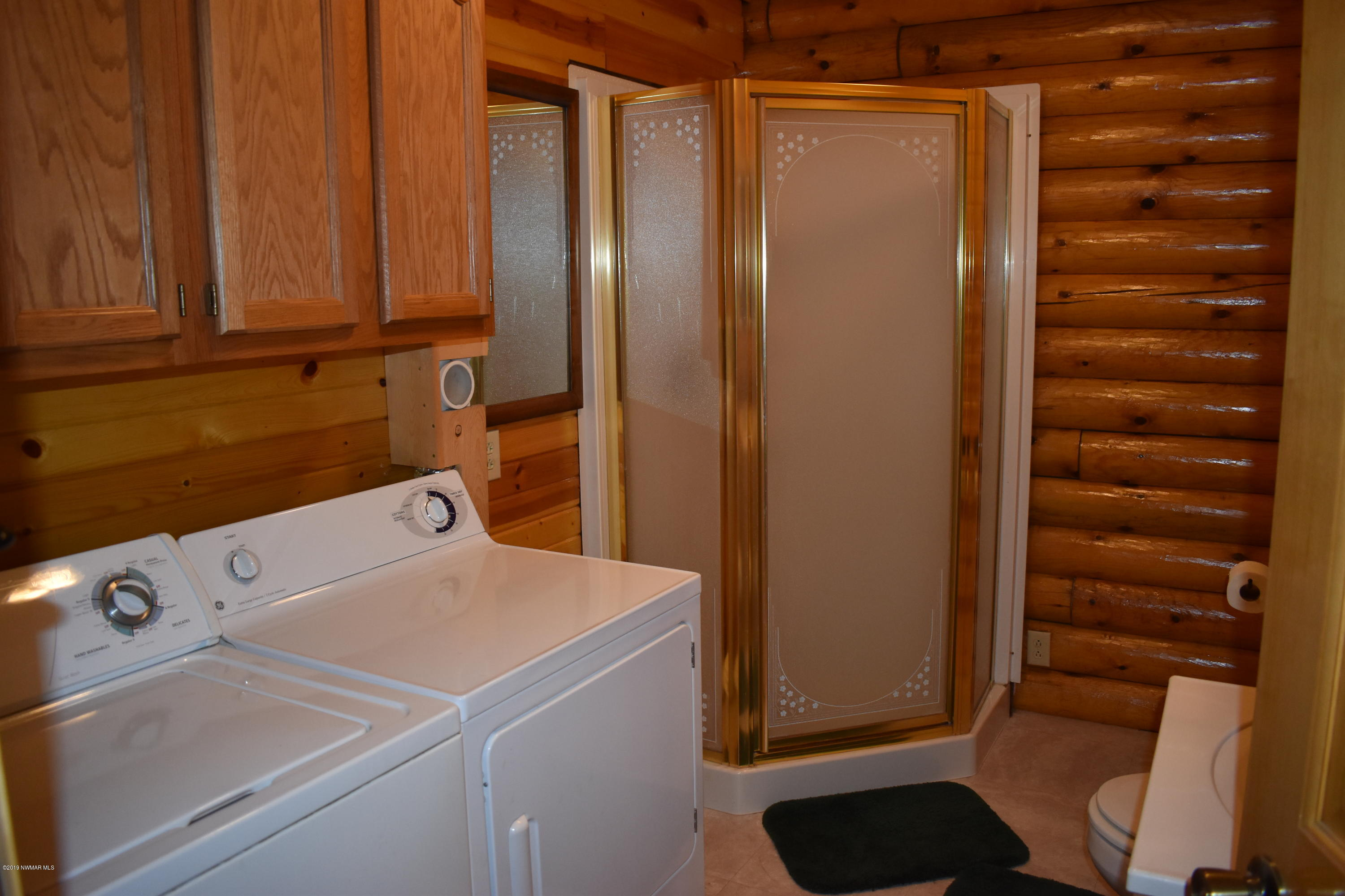 large bathroom and laundry on main floor