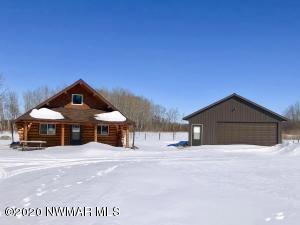 Log cabin and garage on 2.5 acres
