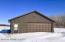 6x22 insulated/heated room with laundry hook up. 8x18 garage door with cement floor- in floor drain