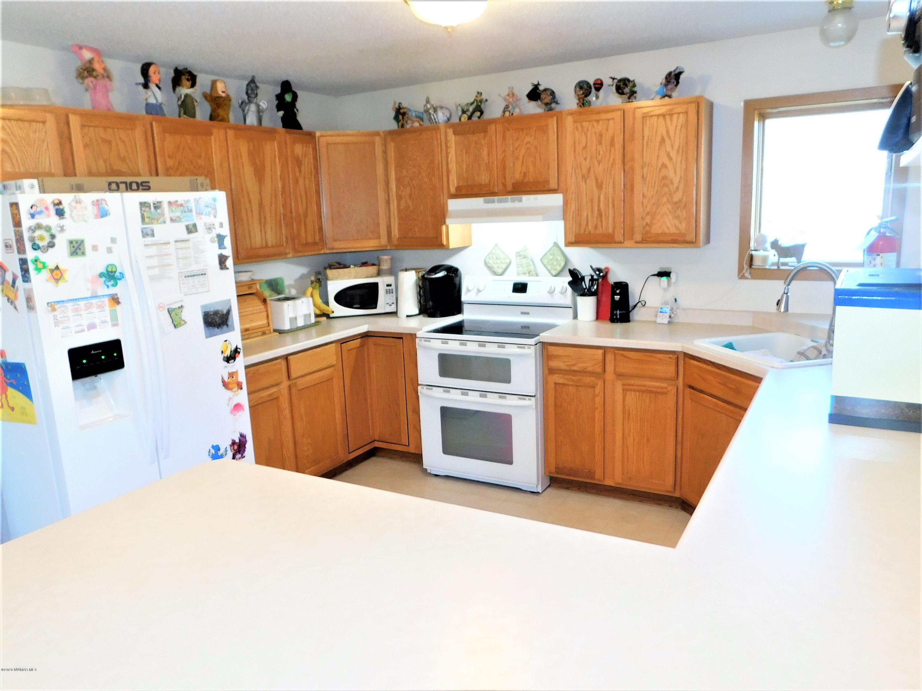 Food Prep is a breeze with the vast amount of kitchen countertops and cabinets.