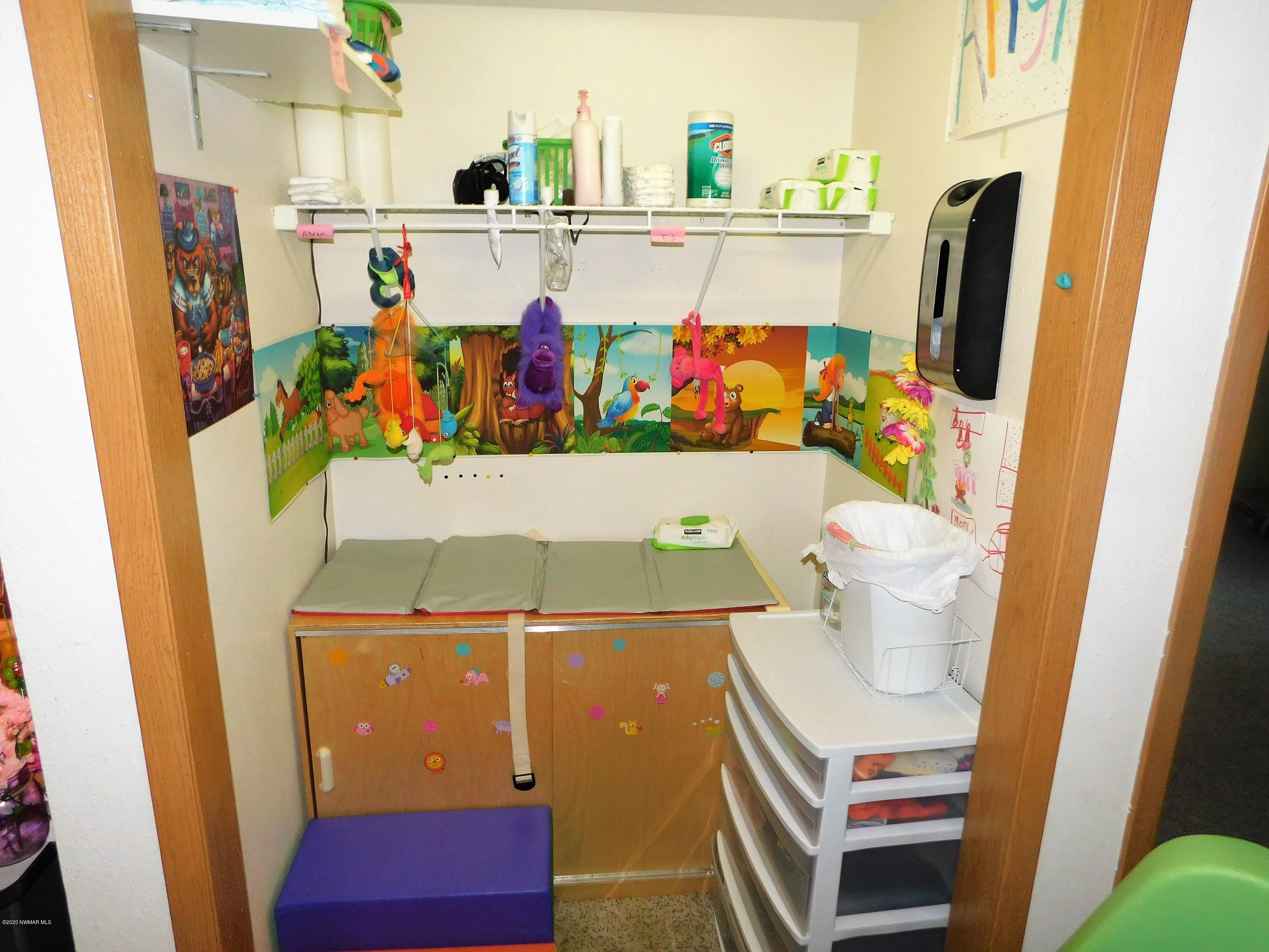 Closet converted to changing area. Great use of space for Daycare or put the door back on and you have a great space for storage.