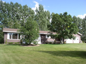 Great panoramic views and sunsets from home nestled among mature trees on NE corner of property. Paved drive to home.