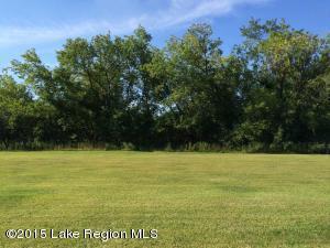 Level 150x150, half acre, east facing, city lot with electric, city sewer and water. Assessment balance paid in full.