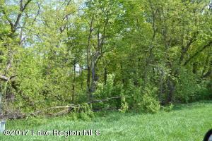 Lida Lake back lot. Several excellent possibilities with lot. Close to Maple Wood State Park and other desirable lakes. Unique place to park your camper and enjoy the area. Located on a dead end road!