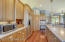 The large kitchen area offers lots of room for people who love to gather in this favorite area