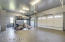 Heated & finished with epoxy floors & a car lift