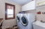 Main floor laundry area with sink