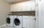 Fully equipped laundry room with granite and great storage!