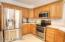 Ample cabinets for storage, plus a pantry cabinet and a breakfast bar...