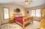 Main level owner's suite with vaulted ceiling, walk-in closet and ensuite bathroom.