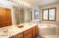 Owner's bathroom with double sink vanity, jetted tub...