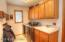 Main level laundry with stainless steel washer/dryer, laundry sink, cabinets...