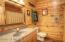 The lower level full bathroom has a tile floor with in-floor heat.