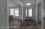 Inviting foyer, bright, hardwood floors, 9 ft ceilings, 8 ft doors and crown molding