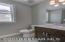 Main Floor Half Bath with 9 ft ceilings, tile floors