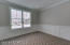 Main Floor Office with custom wainscoting, French doors, crown molding and transom windows allowing for maximum light