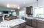 Espresso stained custom cabinetry, center island with storage