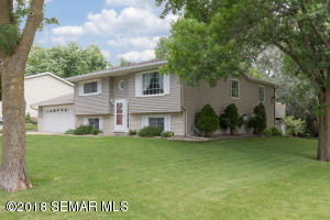 Situated on a large corner lot with mature trees, attached & detached garages, deck, patio, potting shed