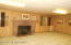 Basement rec room, knotty pine with brick fireplace