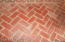 Brick herringbone pattern in screen porch