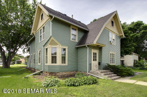 Gorgeous turn of the century has permanent siding and newer roof.