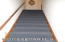 Staircase to upper level bedrooms